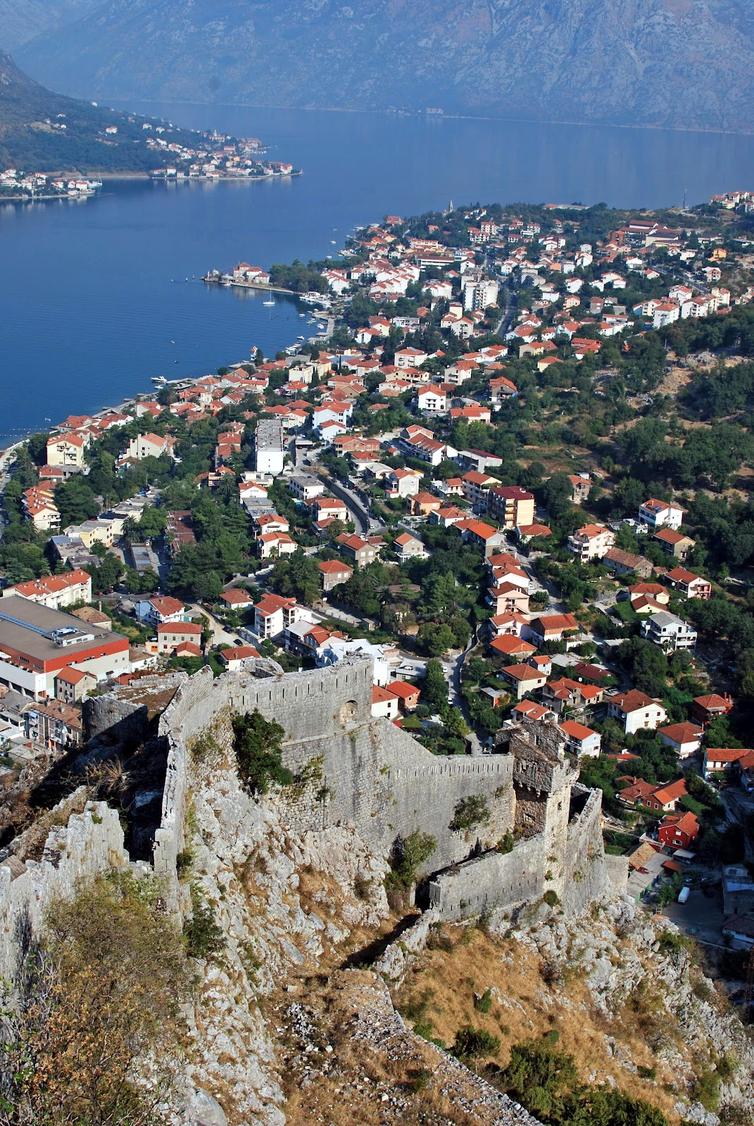 The city of Kotor below a maze of stone Fortifications