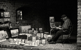 A painter selling his art in Warsaw's Old Town