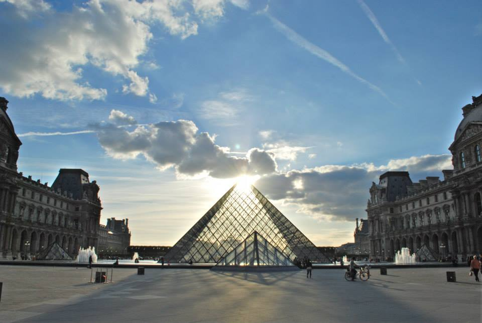 In Jeremy's words: My favorite light photo from our recent long-term trip comes from the Louvre in Paris, France. We were rushing back to our apartment and I just happened to turn around to catch the sun at the most perfect position in the sky