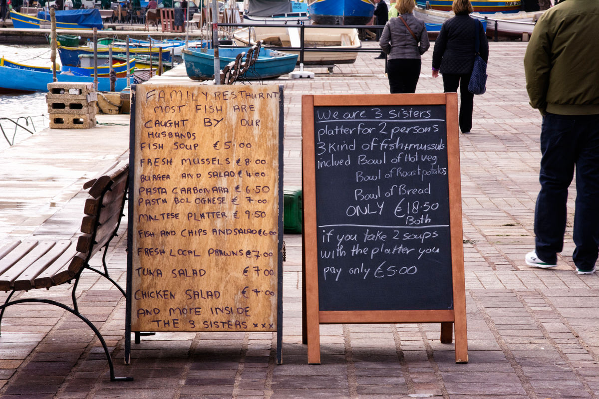 One of the creative sign-boards along the Marsaxlokk promenade