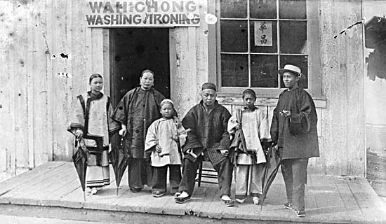 Wah Chong family outside laundry business on Water Street, taken 1884 (via)