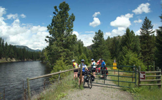 Classic scenery of the Kettle Valley Railway - relatively flat, alongside a waterway, gravel pathway (via)
